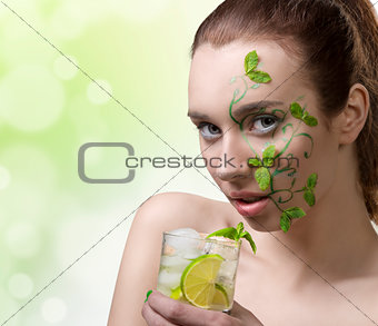 beauty girl drinking mojito with creative make-up