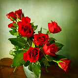 Bunch of red roses on grunge background