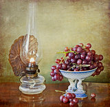 vintage oil lamp and grapes