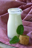 dairy products (yogurt, sour cream) in a glass jar