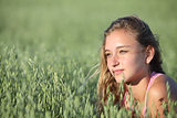 Portrait of a beautiful teenager girl in a oat meadow