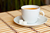 cup of coffee on bamboo tablecloth