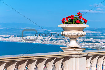 Decorative vase with flowers on the waterfront.