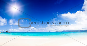 White coral beach sand and azure indian ocean.