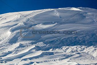 Snow on Peak Vallon at Ski Resort of Corvara, Alta Badia, Dolomi