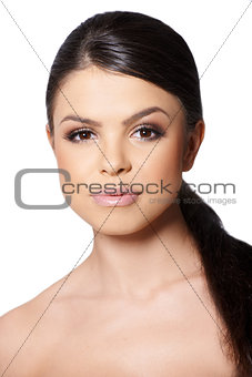 Portrait of brunette girl looking at camera