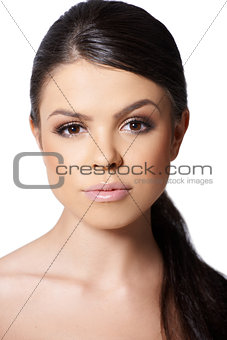 Portrait of beautiful girl looking at camera on white