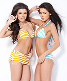 Two beautiful girls posing in swimsuits