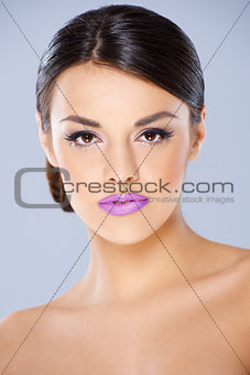 Beautiful girl with violet lips