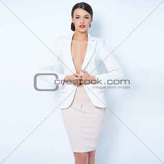 Attractive brunette business woman wearing jacket