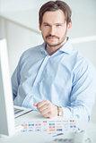Handsome businessman sitting at the desk