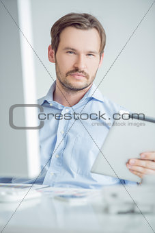 Attractive male sitting at his desk