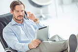 Relaxed businessman talking mobile phone