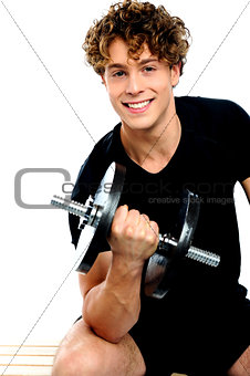 Fit trainer doing biceps exercise