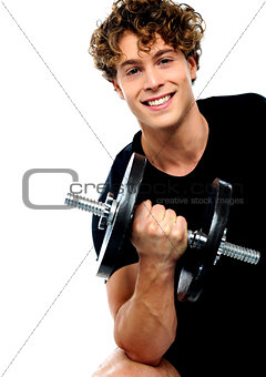 Athlete doing exercise with dumbbell