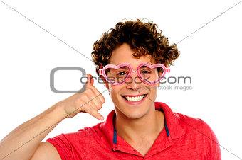 Boy posing with heart shape eye-wear