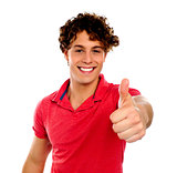 Handsome young man gesturing thumbs-up