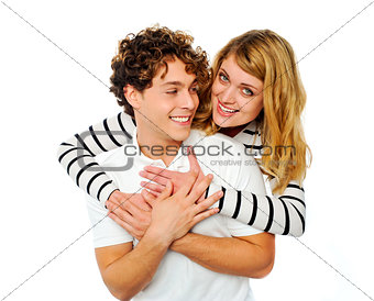 Attractive young couple hugging each other