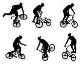 stunt bicyclist silhouettes