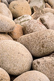 Fine art image of large rounded rocks on beach