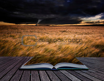 Tornado twister over fields in Summer storm in pages of book