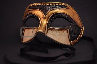 mask on dark background