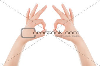 Mask gesture made of two woman's hands.