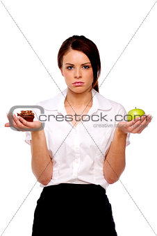 Business woman comparing an apple to cake