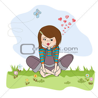 romantic girl sitting barefoot in the grass