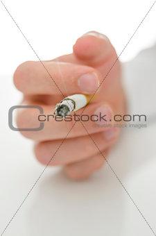 Male hand holding a cigarette