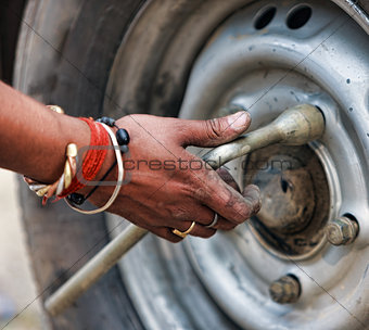 Man changing the car wheel on the road,  close up