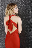 Vogue Style. Elegance. Fashion Woman in Red Prom  Dress. Rear View