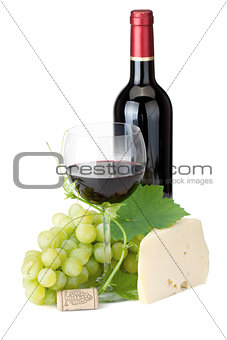 Red wine glass, bottle, cheese and grapes