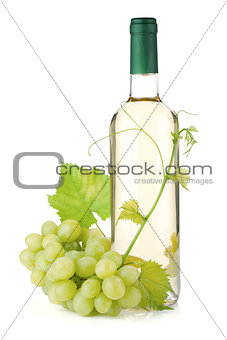 White wine bottle and grapes