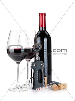 Red wine bottle, glasses, corkscrew, corks and thermometer