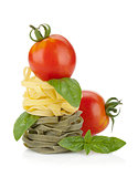 Fettuccine nest pasta with tomato cherry and basil