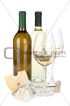 White wine bottles, two glasses, cheese and corkscrew