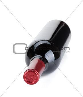 Lying red wine bottle