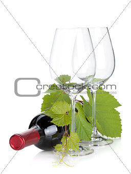 Red wine bottle and empty glasses