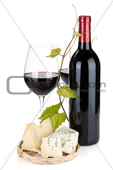 Red wine bottle, glasses and cheese