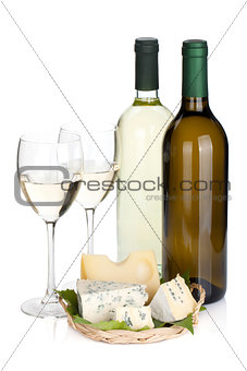 White wine bottles, two glasses and cheese