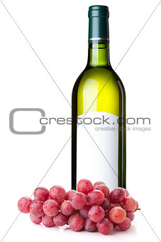 White wine in green bottle and grapes branch