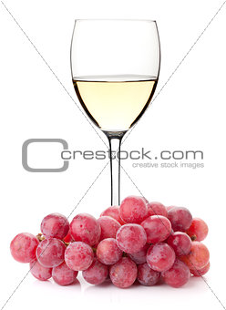 White wine in glass with red grape branch