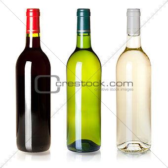 Three closed wine bottles without labels