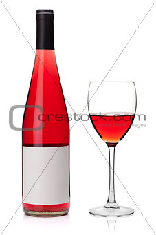 Rose wine in a glass and bottle