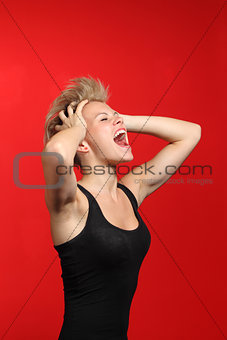 Fashion woman shouting with her hands on the head