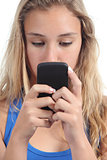 Beautiful teenager girl concentrated in her mobile phone