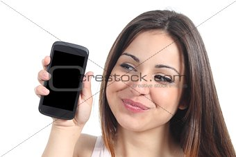 Sweet woman showing a blank mobile phone screen