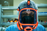 Portrait of woman working in scientific lab wearing gas mask