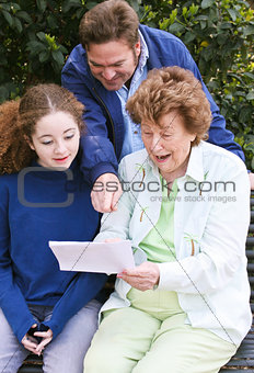 Family Reading Letter Together